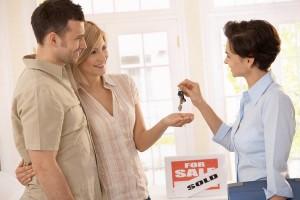 Real Estate Agent Handing Over Keys